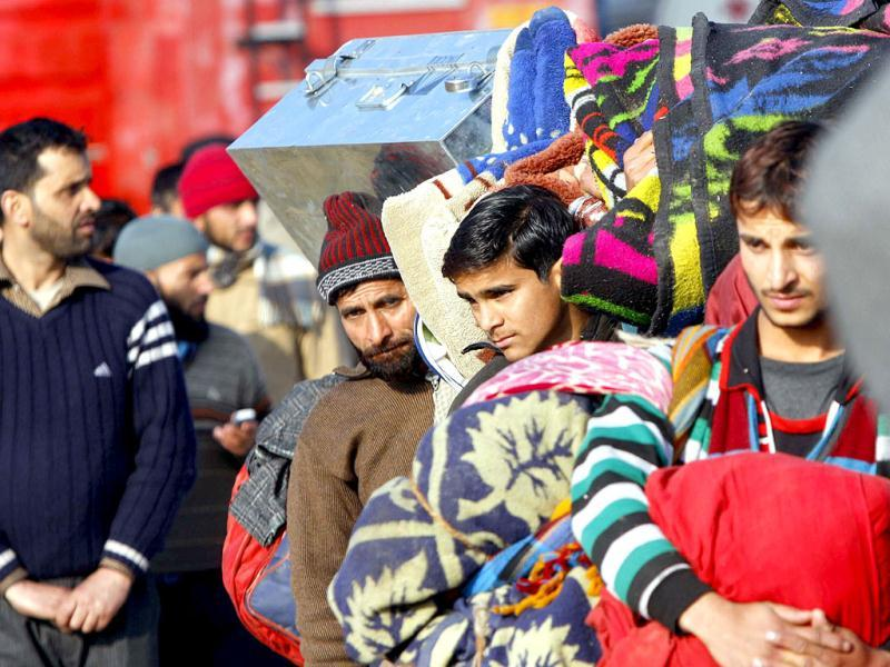 Stranded passengers at Jammu before being airlifted by special IAF plane to Srinagar on Saturday. The passengers were stranded for the last ten days due to inclement weather. HT Photo/Nitin Kanotra.