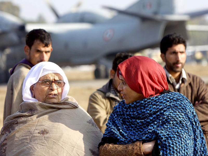 Stranded passengers at Jammu before being airlifted by special IAF plane to Srinagar on Saturday. The passangers were stranded for the last ten days. HT Photo/Nitin Kanotra.