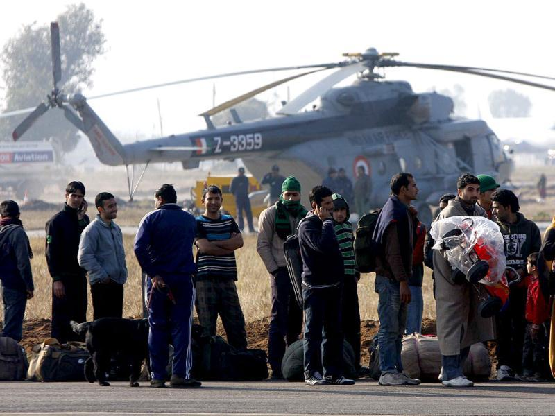 Stranded passengers at Jammu being airlifted by special IAF plane to Srinagar on Saturday. The passengers were stranded for the last ten days. HT Photo/Nitin Kanotra.