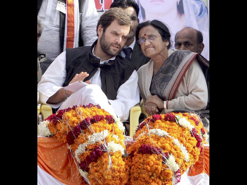 Congress general secretary Rahul Gandhi talks with UPCC chief Rita Bahuguna Joshi during an election rally near Allahabad. PTI Photo