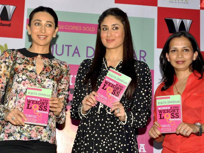 The Kapoor sisters hold up copies of Diwekar's (right) book Women and the Weight Loss Tamasha.