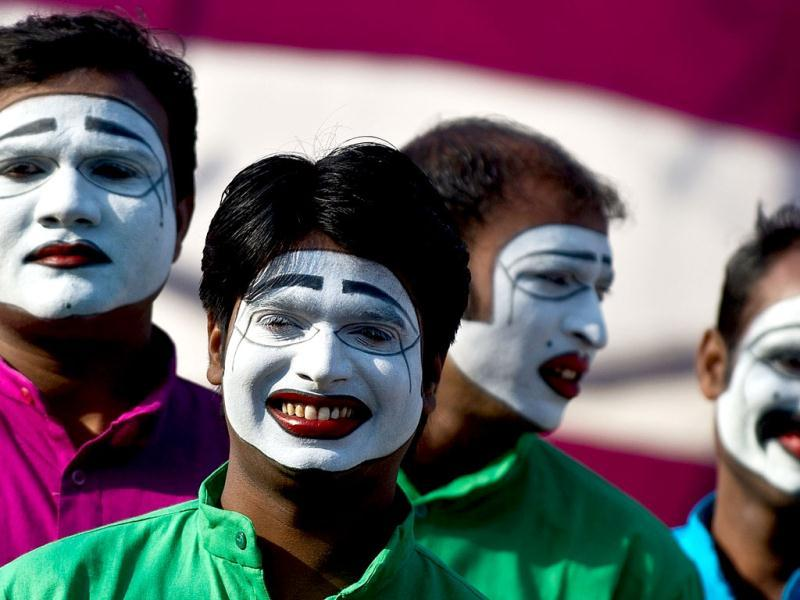 Mime artists from the Ministry of Communication and Information Technology tableaux pose during a press preview for the Republic Day parade, in New Delhi. AFP Photo/ Manan Vatsyayana