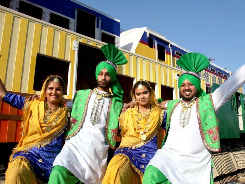 Artists of Indian Railways tableaux, participating in the forthcoming Republic Day function, pose for a photo during a press preview in New Delhi. PTI Photo /Vijay Verma