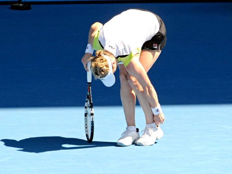 Kim Clijsters of Belgium adjusts her sock after slipping on the court while playing against Li Na of China in their fourth round women's singles match on day seven of the 2012 Australian Open tennis tournament in Melbourne. AFP photo/Torsten Blackwood