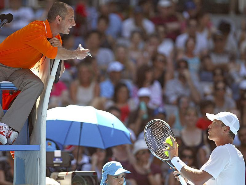 Tomas Berdych of the Czech Republic, right bottom, argues with umpire as he plays Nicolas Almagro of Spain during their fourth round match at the Australian Open tennis championship in Melbourne, Australia. (AP Photo/Rick Rycroft)