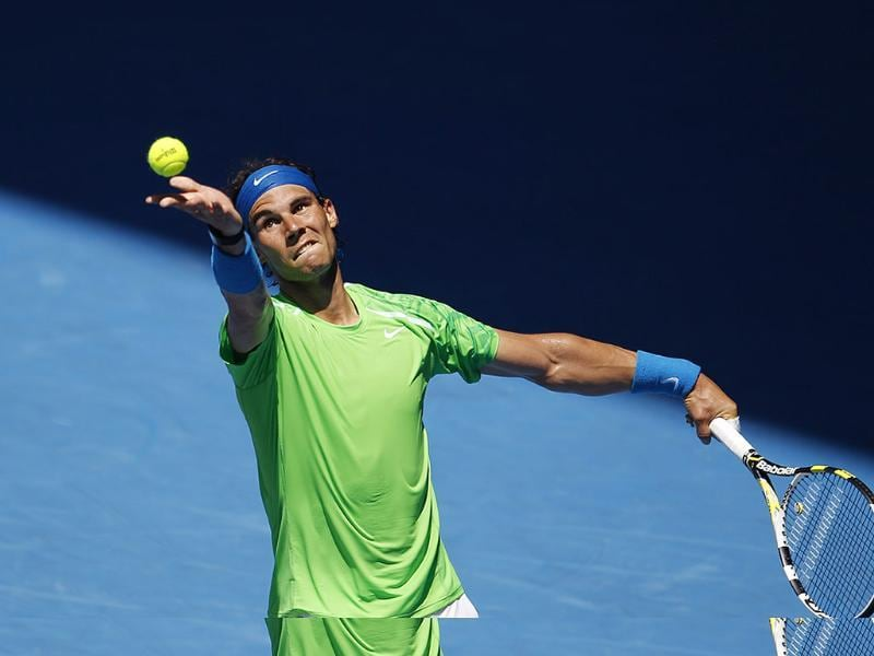 Spain's Rafael Nadal serves during his fourth round match against compatriot Feliciano Lopez at the Australian Open tennis championship in Melbourne, Australia. (AP Photo/Aaron Favila)