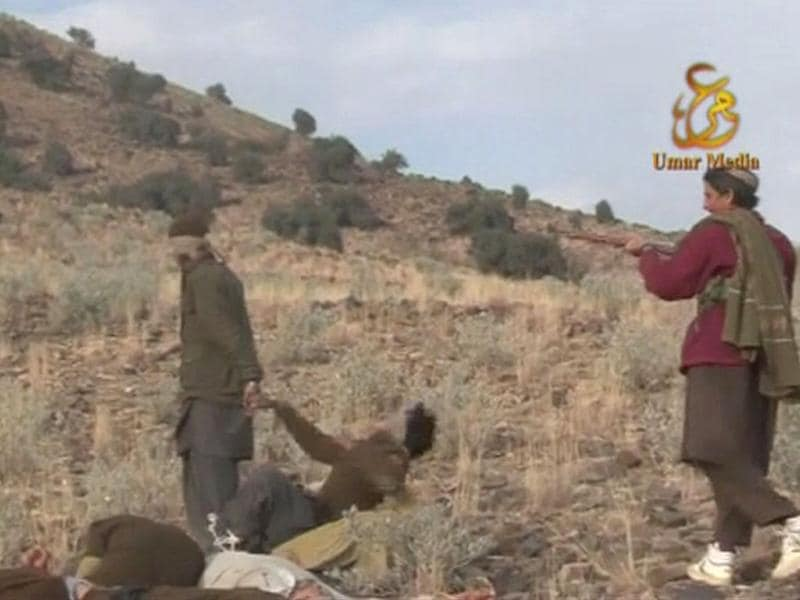 A Taliban militant shoots and kills a Pakistani soldier in this still image taken from a video obtained by Reuters.