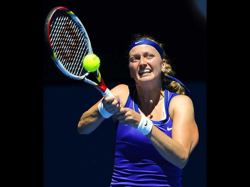 Petra Kvitova of the Czech Republic makes a backhand return during her fourth round match against Serbia's Ana Ivanovic at the Australian Open tennis championship, in Melbourne, Australia. (AP Photo/Andrew Brownbill)