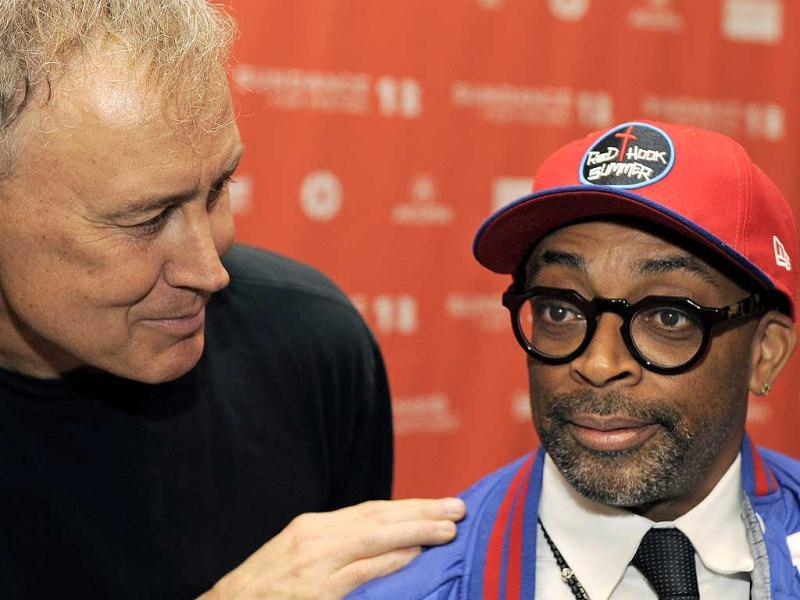 Bruce Hornsby, left, composer for the film Red Hook Summer, talks with the film's writer/director Spike Lee, right, at the premiere of the film at the 2012 Sundance Film Festival in Park City, Utah. (AP Photo/Chris Pizzello)