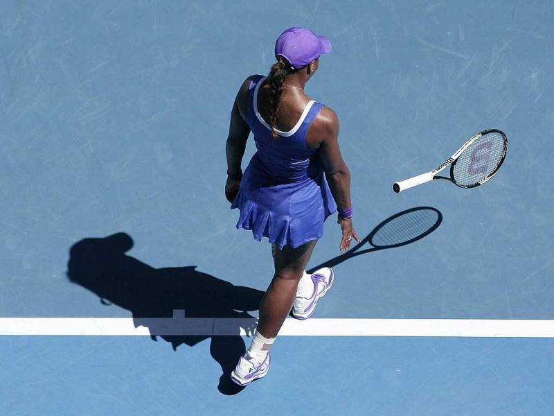 Serena Williams of the US throws her racket in frustration during her fourth round match Russia's Ekaterina Makarova at the Australian Open tennis championship, in Melbourne, Australia. (AP Photo/John Donegan)