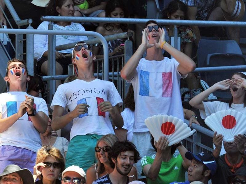 Spectators cheer for Jo-Wilfried Tsonga of France during his men's singles match against Kei Nishikori of Japan on the eighth day of the Australian Open tennis tournament in Melbourne. (AFP photo/Paul Crock)