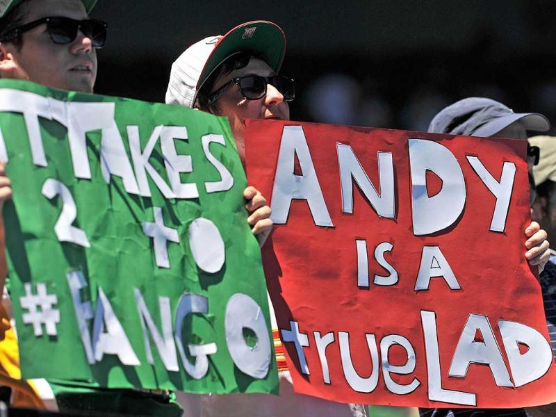 Supporters hold up placards to cheer on Andy Murray of Britain as he plays Mikhail Kukushkin of Kazakhstan in their fourth round men's singles match on day eight of the 2012 Australian Open tennis tournament in Melbourne. (AFP PHOTO /Nicolas Asfouri)