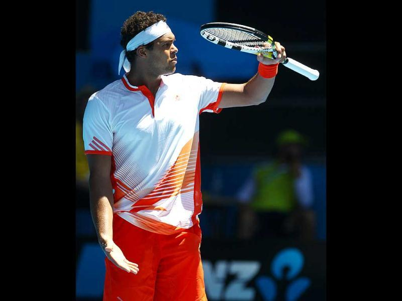 France's Jo-Wilfried Tsonga gestures to the umpire during his fourth round match against Japan's Kei Nishikori at the Australian Open tennis championship, in Melbourne. (AP Photo/Rick Rycroft)