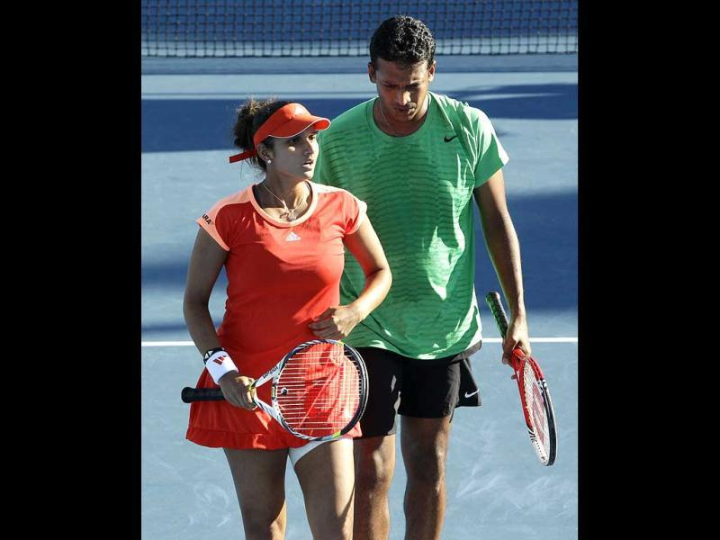 Sania Mirza and Mahesh Bhupathi play Iveta Benesova of the Czech Republic and Jurgen Melzer of Austria during their second round mixed doubles match at the Australian Open tennis championship, in Melbourne. (AP Photo/Sarah Ivey)