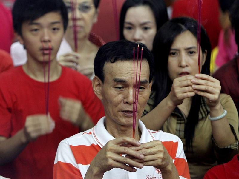 Filipino-Chinese pray inside a Chinese temple in celebration of the Chinese New Year at Manila's Chinatown district in the Philippines. This year is the Year of the Dragon in the Chinese calendar. AP Photo/Bullit Marquez