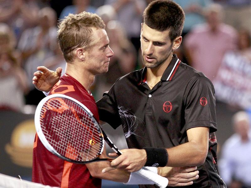 Novak Djokovic (R) of Serbia embraces Lleyton Hewitt of Australia after their men's singles match at the Australian Open tennis tournament in Melbourne. Reuters/Daniel Munoz