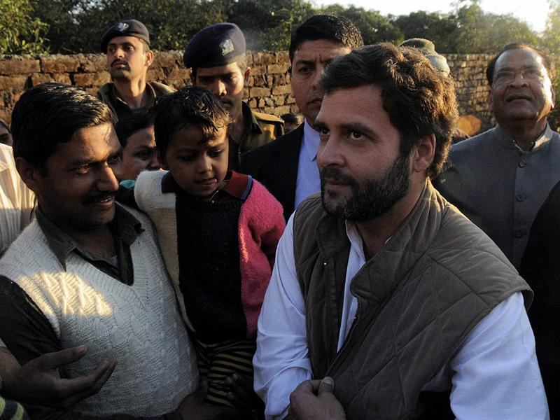 AICC General Secretary Rahul Gandhi with people after a rally in Vikas Nagar in Dehradun on Monday. PTI Photo