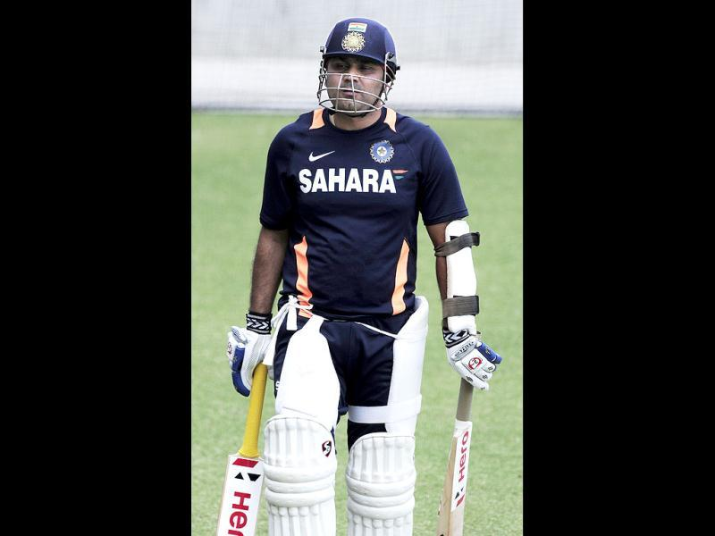 Virender Sehwag prepares for training at the nets before the opening day of cricket against Australia in Adelaide, Australia. -AP Photo/David Mariuz