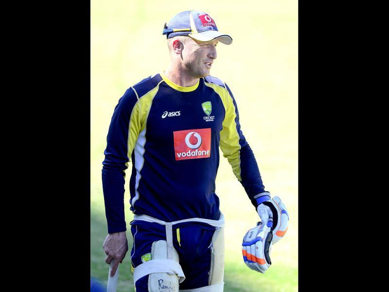 Australia's wicketkeeper Brad Haddin prepares for training at the nets before the opening day of cricket against India in Adelaide, Australia. -AP Photo/David Mariuz