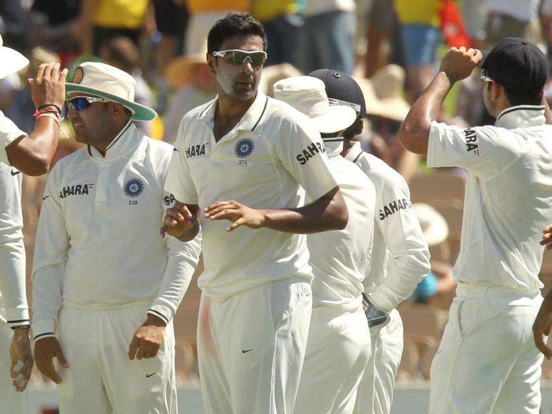 Indian spin bowler Ravi Ashwin (C) celebrates with teammates after taking the wicket of Australian batsman Shaun Marsh on day 1 of the fourth cricket Test match against India in the Border-Gavaskar Trophy Series at the Adelaide Oval. AFP Photo/Tony Ashby