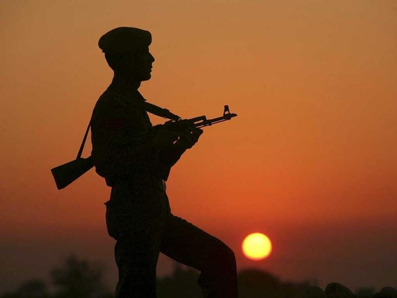 A policeman is silhouetted against the setting sun as he stands guard on the banks of river Tawi ahead of India's Republic Day celebrations in Jammu. Reuters/Mukesh Gupta