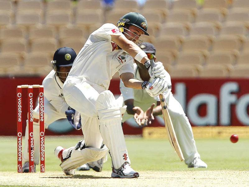 Australia's Ed Cowan plays a shot and is caught out by India's VVS Laxman during the first day of the fourth Test cricket match in Adelaide. Reuters/Brandon Malone.