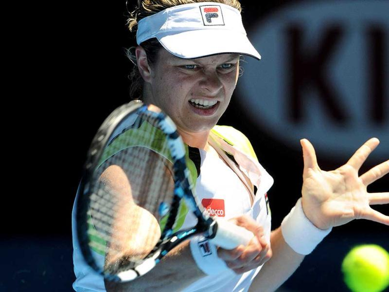 Kim Clijsters of Belgium hits a return against Caroline Wozniacki of Denmark in their women's singles quarter-final match on day nine of the 2012 Australian Open tennis tournament in Melbourne. AFP PHOTO / TORSTEN BLACKWOOD
