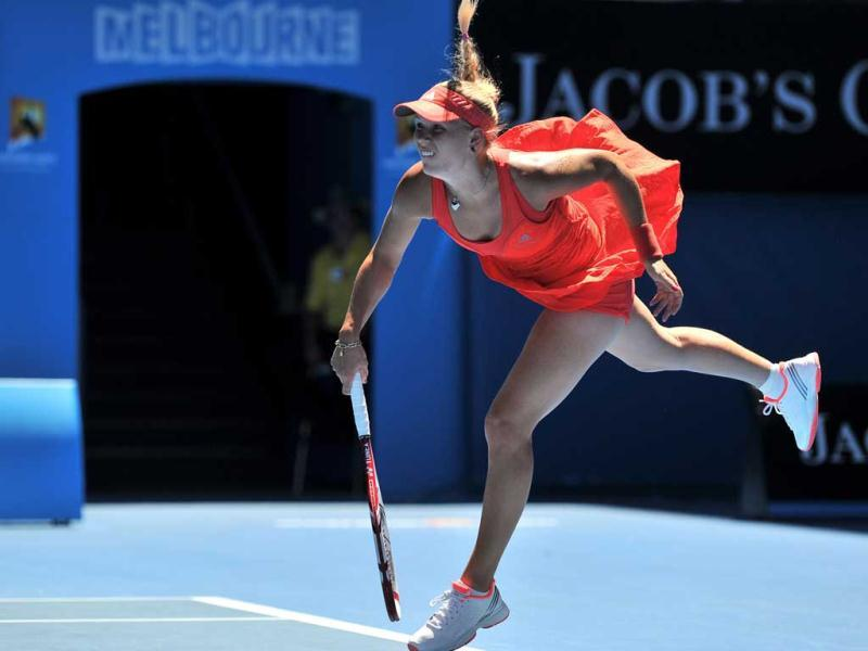 Caroline Wozniacki of Denmark serves against Kim Clijsters of Belgium in their women's singles quarter-final match on day nine of the 2012 Australian Open tennis tournament in Melbourne. AFP PHOTO / NICOLAS ASFOURI