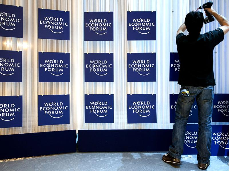 A worker makes the last preparations inside the Congress Center two days before the opening of the 42nd Annual Meeting of the World Economic Forum, WEF, in Davos, Switzerland. (AP Photo/Keystone/Laurent Gillieron)