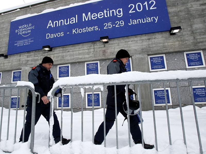 Swiss police officers pass by the Congress Center the day before the opening of the 42nd Annual Meeting of the World Economic Forum, WEF, in Davos, Switzerland, Tuesday .(AP Photo/Michel Euler)