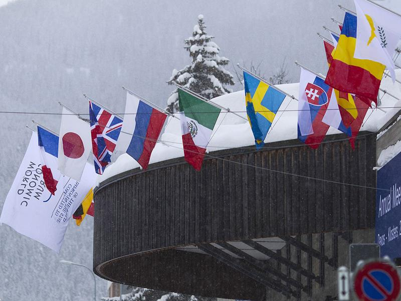 The roof of the Congress Centre is covered with snow the day before the opening of the 42nd Annual Meeting of the World Economic Forum, WEF, in Davos, Switzerland, Tuesday. (AP Photo/Anja Niedringhaus)
