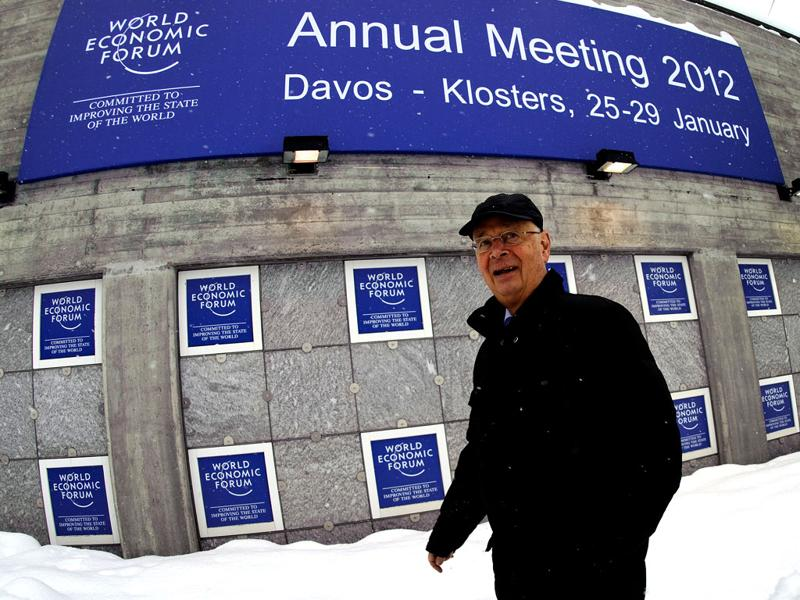 World Economic Forum (WEF) founder and executive chairman Klaus Schwab walks outside the Congress Center in the Swiss resort of Davos. (AFP Photo /Fabrice Coffrini)