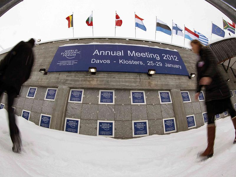 People walk past logos of the World Economic Forum (WEF) in front of the congress center in the Swiss mountain resort of Davos. The upcoming WEF will be held from January 25 to 29.(REUTERS/Arnd Wiegmann)