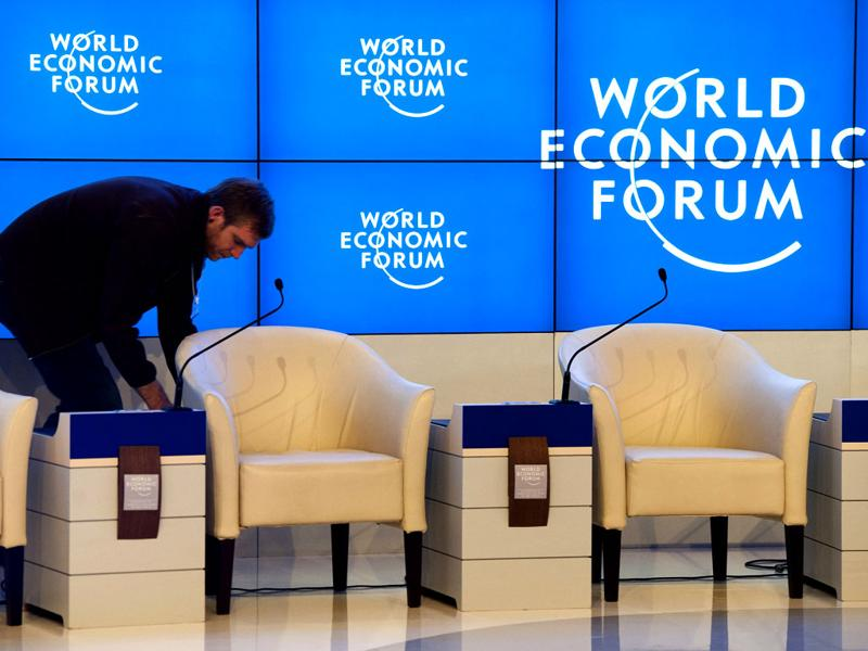 A worker makes last minute preparations inside the Congress Center the day before the opening of the 42nd Annual Meeting of the World Economic Forum, WEF, in Davos, Switzerland.(AP Photo/Keystone/Laurent Gillieron)