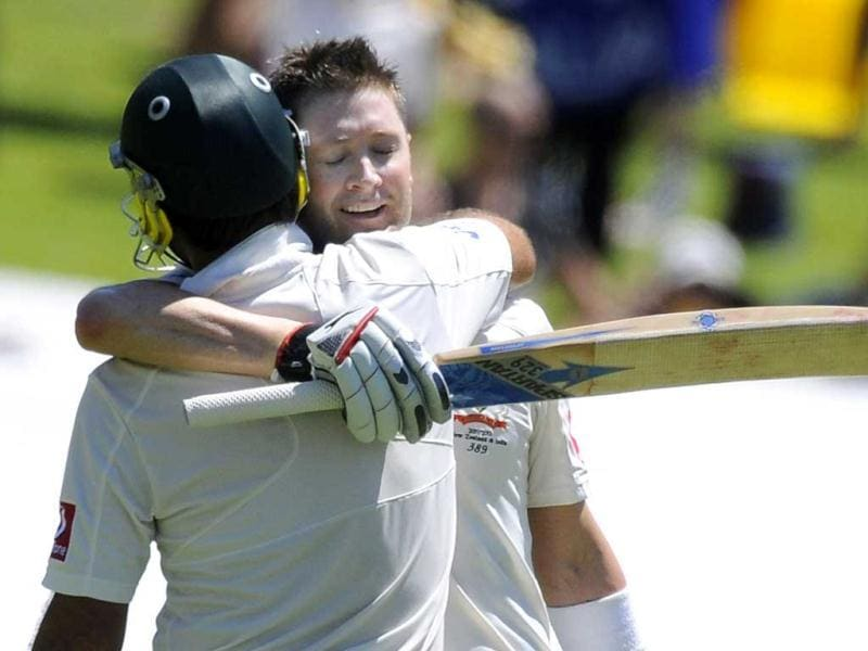 Michael Clarke, back, celebrates his double century with teammate Ricky Ponting during their fourth cricket Test match against India in Adelaide. AP Photo/David Mariuz.
