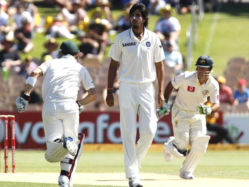 Ishant Sharma watches as Australian captain Michael Clarke and Ricky Ponting run between the wickets during the second day of the fourth Test cricket match against India in Adelaide. Reuters Photo/Brandon Malone.