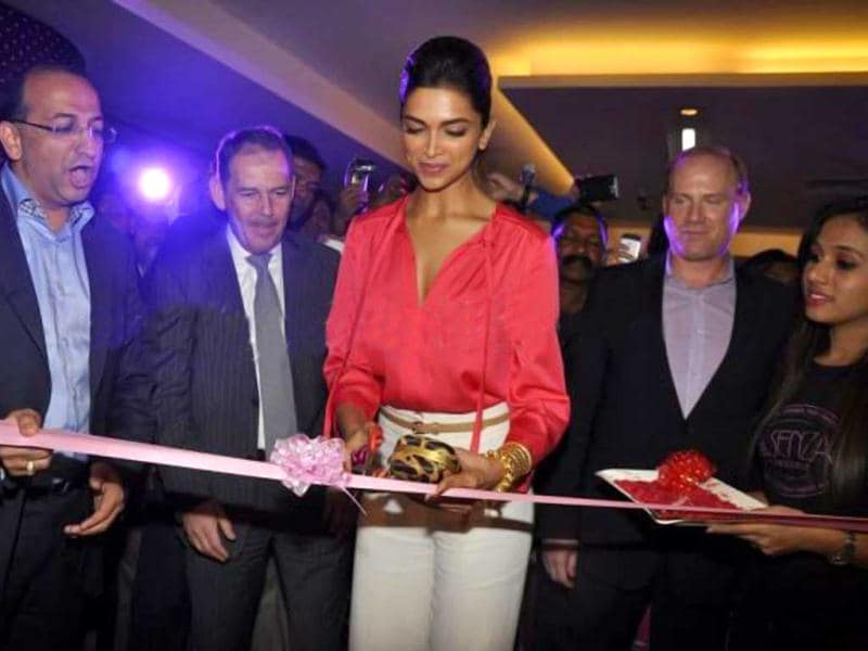 Deepika cuts the ribbon at the launch of La Senza store in Mumbai on Jan 24.