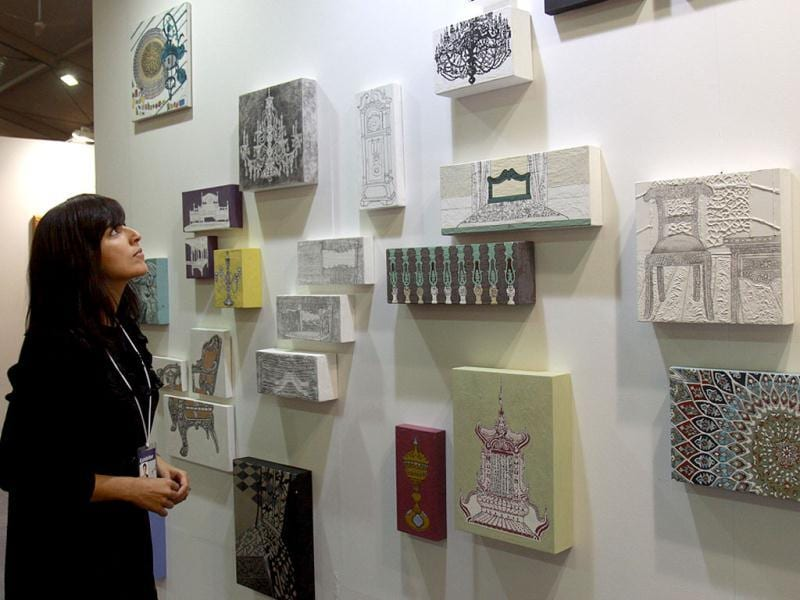 An art enthusiast looks at exhibits on display at the India Art Fair in New Delhi. (HT Photo/Arijit Sen)