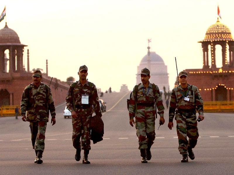 Security personnel patrol at Vijay Chowk on the eve of the 63rd Republic Day in New Delhi. PTI Photo by Kamal Singh