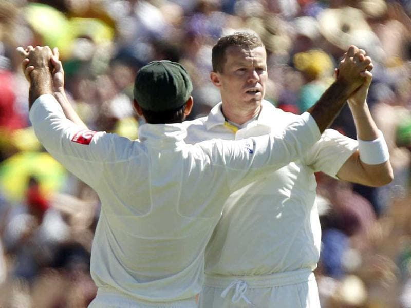 Peter Siddle of Australia celebrates with Ricky Ponting after taking the wicket of Sachin Tendulkar during the third day of the fourth Test cricket match in Adelaide. Reuters/Brandon Malone