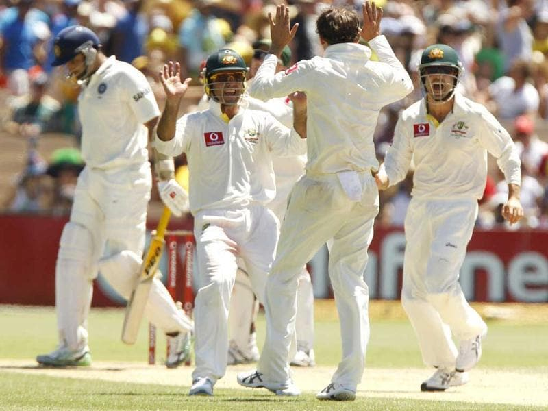 VVS Laxman of India walks off as Ricky Ponting (2nd L) and bowler Nathan Lyon (2nd R) of Australia celebrate during their third day of the fourth Test cricket match in Adelaide. Reuters/Brandon Malone
