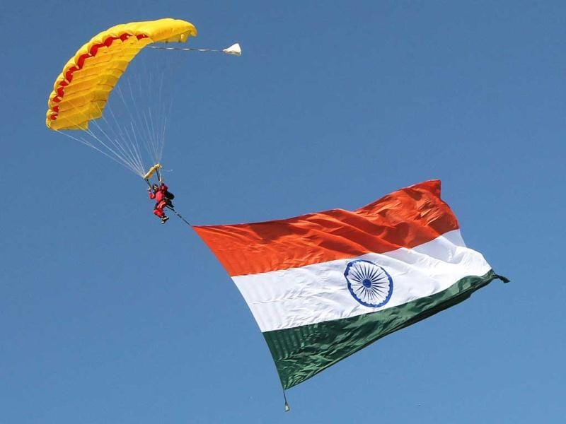 A parachutist brings the Indian flag to Adelaide Oval prior to the start of play on day 3 of the fourth cricket Test match against Australia in the Border-Gavaskar Trophy Series at the Adelaide Oval. AFP Photo/Tony Ashby