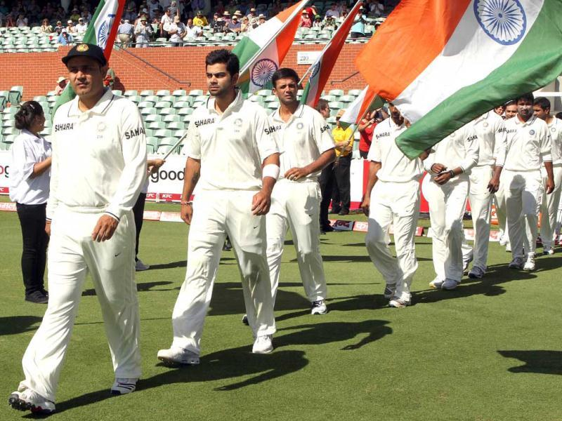 Indian captain Virender Sehwag leads his team on to the oval for the national anthems prior to the start of play on day 3 of the fourth cricket Test match against Australia in the Border-Gavaskar Trophy Series at the Adelaide Oval. Today marks Australia Day and India Republic Day respectively. AFP Photo/Tony Ashby