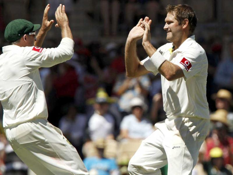 Ryan Harris (R) of Australia celebrates with Michael Hussey after taking the wicket of Wriddhiman Prasanta Saha of India during the third day of their fourth Test cricket match in Adelaide. Reuters/Brandon Malone