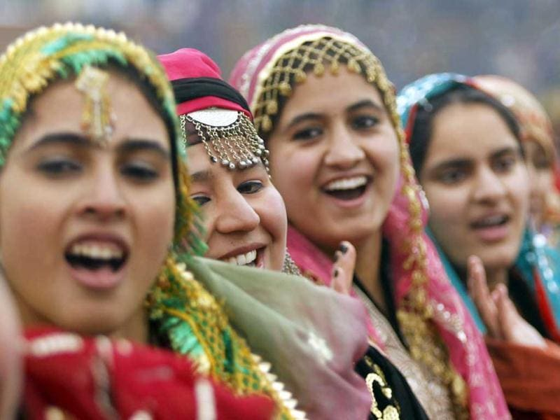 Schoolgirls wearing traditional dresses perform to a patriotic song during Republic Day celebrations in Srinagar. Reuters photo/Fayaz Kabli