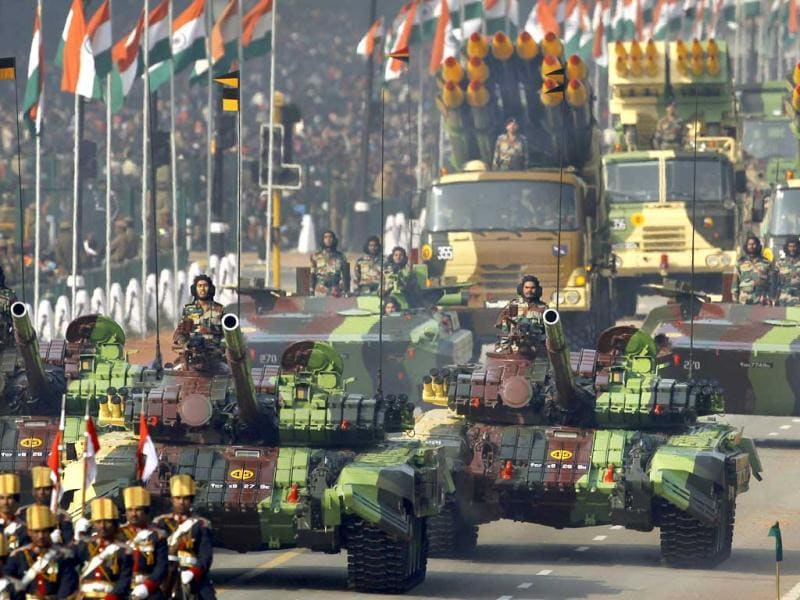 Indian Army soldiers ride on T-72 tanks on Rajpath during the main Republic Day parade in New Delhi. AP Photo/Kevin Frayer