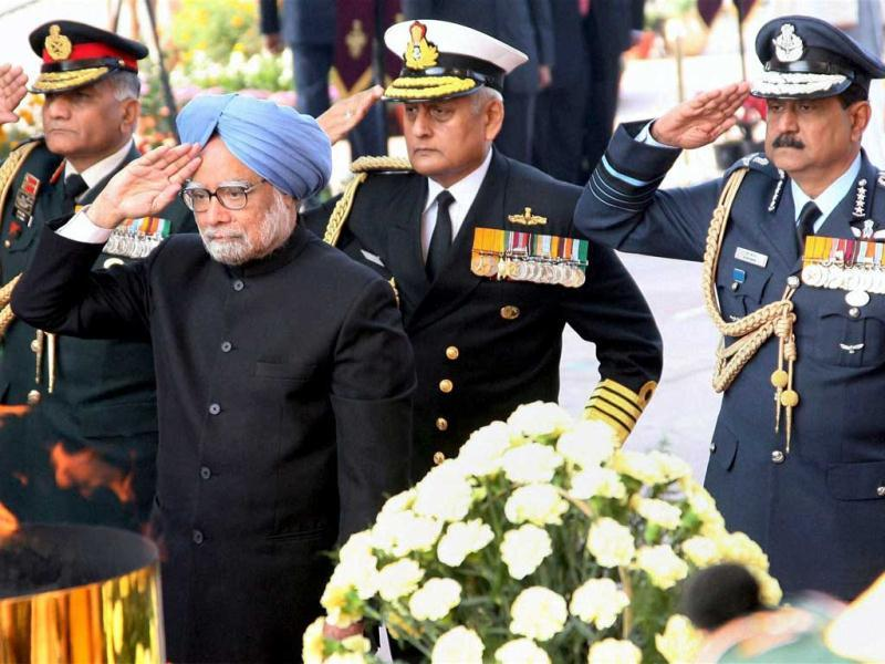 Prime Minister Manmohan Singh with Army Chief Gen VK Singh, Navy Chief Nirmal Verma and IAF Chief Air Chief Marshal paying homage at Amar Jawan Jyoti during 63rd Republic Day function in New Delhi. PTI Photo
