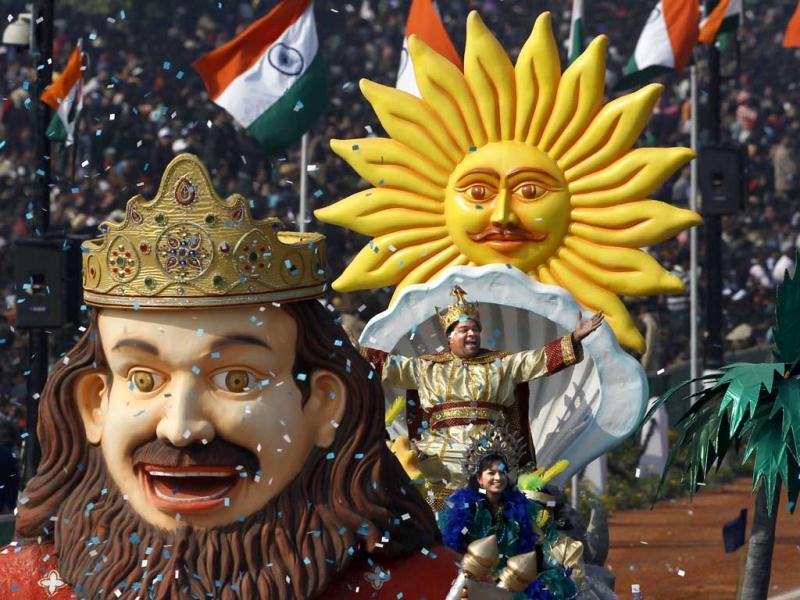 Performers wave to the crowd from the float of the Indian state of Goa on Rajpath during the main Republic Day parade in New Delhi. AP Photo/Kevin Frayer