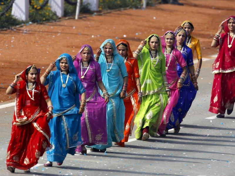 Women dance during the main Republic Day parade in New Delhi. AP Photo/Kevin Frayer