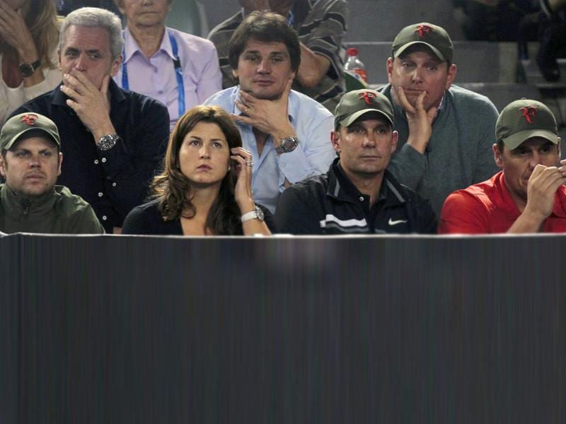 Miroslava Mirka Vavrinec (2nd L), wife of Roger Federer, watches the men's singles semifinal match at the Australian Open tennis tournament in Melbourne. Reuters/Vivek Prakash